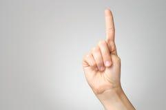 在女性手指的膏药 图库摄影