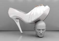 在女性脚跟下的人的头 免版税库存图片