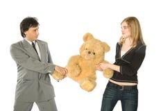 在女用连杉衬裤的熊战斗 免版税库存图片
