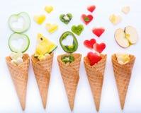 在奶蛋烘饼果子设定锥体和心脏形状的各种各样的果子  免版税库存照片