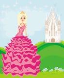 在她的城堡前面的美丽的年轻女王/王后 库存图片