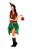在她的手指的妇女垂悬的圣诞节泡影 免版税库存图片