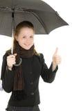 在好的妇女之下的伞 免版税库存照片