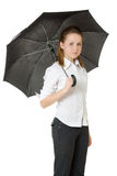 在妇女之下的伞 免版税库存图片