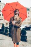 在妇女之下的伞 免版税图库摄影