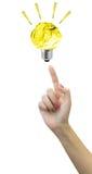 在妇女指尖的纸电灯泡光白色背景的 免版税库存照片
