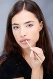在妇女的嘴唇的铅笔 免版税库存图片