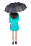 在妇女年轻人之下的伞 免版税库存照片
