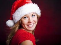 在妇女年轻人的圣诞节黑暗 免版税库存照片
