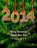 在姜饼形状的新年2014年反对杉木的 免版税库存图片