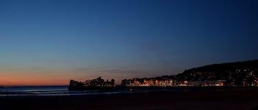 在威斯顿超级母马码头和镇的日落 免版税库存图片