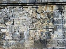 在婆罗浮屠寺庙的石墙,印度尼西亚 库存图片