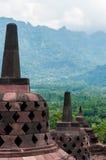 在婆罗浮屠顶部的Stupas 图库摄影