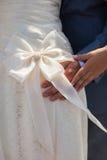 在婚礼礼服的女傧相弓 免版税图库摄影