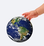 在子项的现有量的地球,查出在白色 免版税库存照片