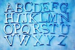 在字母表上写字 免版税库存图片