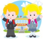 在学校前的学童 库存例证