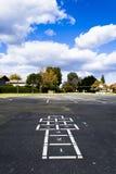 在学校操场的跳房子 免版税库存图片