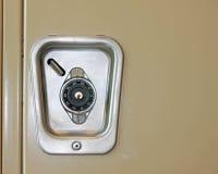 在学校衣物柜的号码锁 免版税库存图片