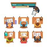 在孩子前面的老师教室的 库存图片