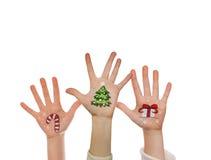 在孩子的手上绘的圣诞节标志 圣诞老人,雪人,圣诞树,当前箱子 库存照片