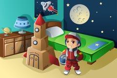 在宇航员服装穿戴的孩子 免版税库存图片