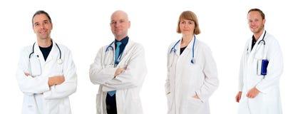 在实验室外套的友好的医疗队 免版税库存图片