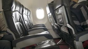 在客舱的空的飞机位子 免版税图库摄影
