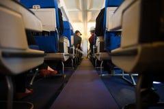 在客舱里面的乘客 图库摄影
