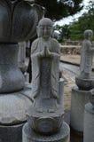 在宫岛海岛上的菩萨雕象 图库摄影