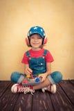 在家使用孩子的飞行员 图库摄影