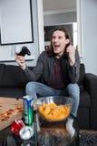 在家坐愉快的人的游戏玩家和戏剧比赛 库存图片