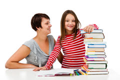 做家庭作业的女孩隔绝在白色背景 库存照片
