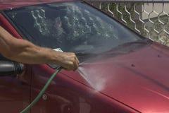 在家洗涤的汽车 免版税库存照片