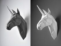 在对比背景的两个黑白独角兽头 免版税库存照片