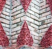 在寺庙墙壁上的泰国样式 免版税图库摄影