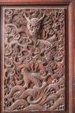 在寺庙大厅门抚顺县的抚顺,四川精妙的雕塑 免版税图库摄影