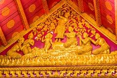 在寺庙的墙壁上的浅浮雕在Louangphabang,老挝 特写镜头 免版税图库摄影