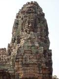 在寺庙的被雕刻的石面孔在吴哥窟 库存照片