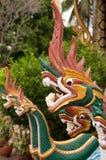 在寺庙的龙用在它的嘴的米 库存图片
