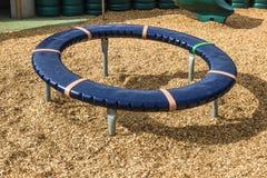 在小儿童游戏地区的圆的圆环 库存照片