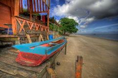 在小屋的小船 图库摄影