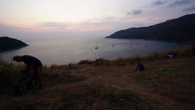 在小山和海背景录影timelapse的日落 影视素材