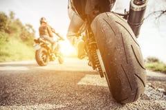 在小山的两辆摩托车 库存图片