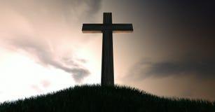 在小山的耶稣受难象在黎明 免版税库存照片