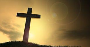 在小山的耶稣受难象在黎明 图库摄影