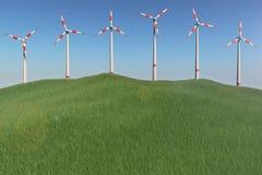 在小山的风车 免版税库存照片