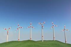 在小山的风车 免版税图库摄影