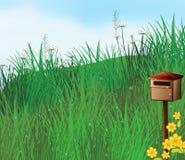 在小山附近的一个邮箱 库存照片
