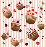 在小条桃红色背景的杯形蛋糕 免版税库存图片